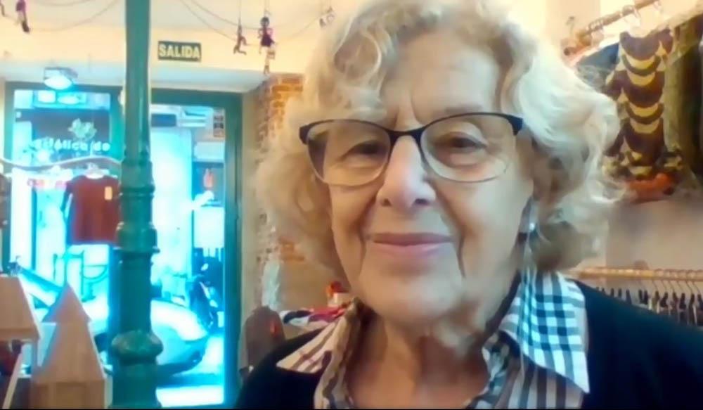 Manuela Carmena en la EC desde la tienda Zaptelas